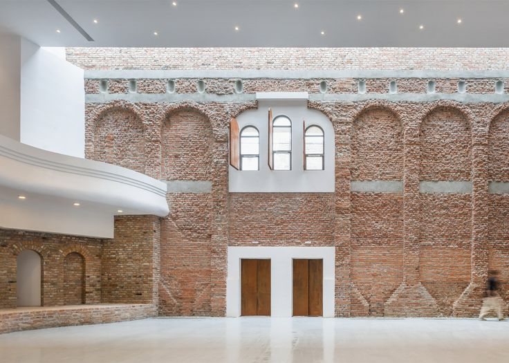 """Ruined """"cultural palace"""" in Romania revived by architect Vlad Rusu"""