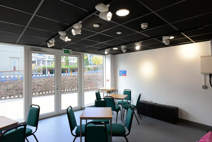 Further Education and Technical College to form Newcastle College, Armstrong's black Mesh metal tiles above the semi-circular