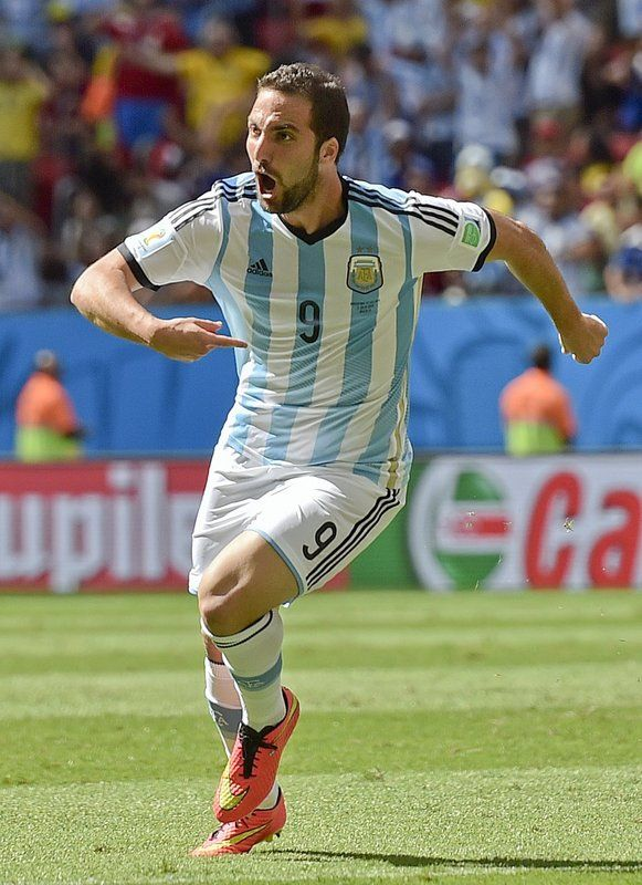 FIFA World Cup 2014 - Argentina 1 Bélgica 0 (7.5.2014) - El Nuevo Herald Argentina's Gonzalo Higuain celebrates after scoring the opening goal during the World Cup quarterfinal soccer match between Argentina and Belgium at the Estadio Nacional in Brasilia, Brazil, Saturday, July 5, 2014. Martin Meissner / AP