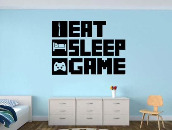 "Best gift for a gamer. Already have a gamer themed game room? Add to it with this awesome Eat Sleep Game decal. Measures 30"" wide and 22"" tall. Measure before o"