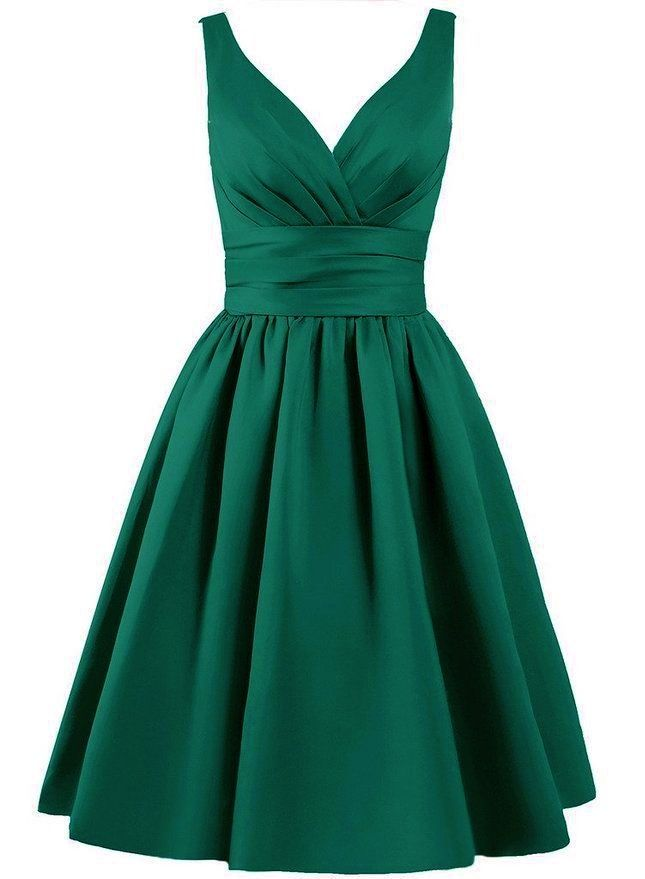 Beautiful knee length matte satin dress available in emerald green V shaped pleated neckline The bodice is boned and has hidden bust support to offer