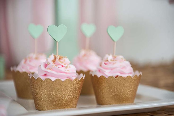 Sparkly cupcakes at a pink and gold bridal shower party! See more party ideas at CatchMyParty.com!