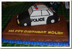 Police car decorated with black and white fondant with the Wilton 3D cruiser cake pan