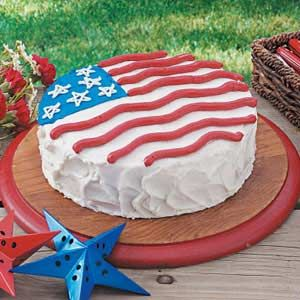 Patriotic Cake ~ This impressive Patriotic Cake makes for a pretty presentation on a picnic table. It conveniently starts with a boxed cake mix, then is topped with a sweet homemade frosting.