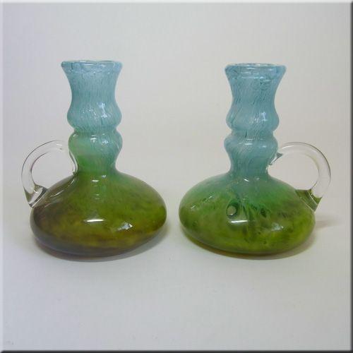 Pair of Ekenas Glasbruk Swedish pale blue + green glass candlesticks, designed by John-Orwar Lake, signed to base.