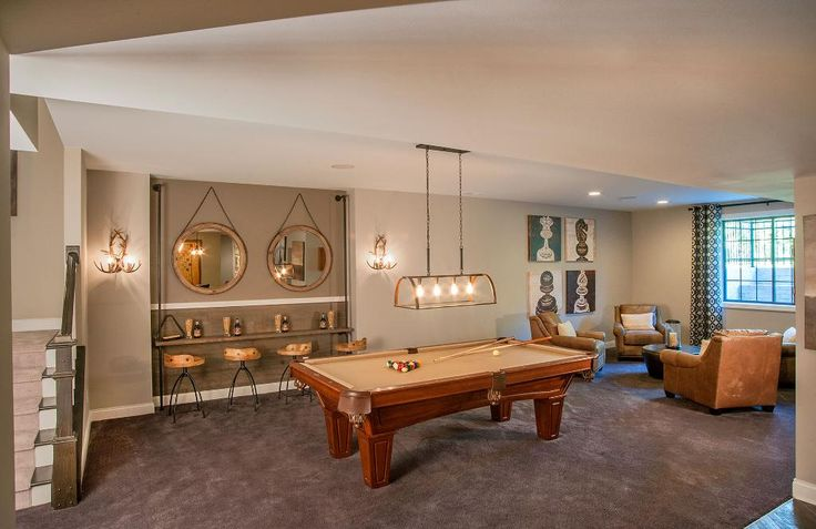 Finished lower level recreation room with pool table; The Monticello floor plan, Drees Homes, Indianapolis