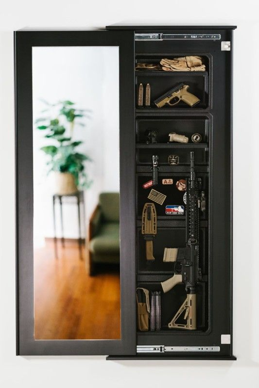 Built in and hidden gun cabinet kit that looks like a framed mirror. Locks with a magnetic key for safety.