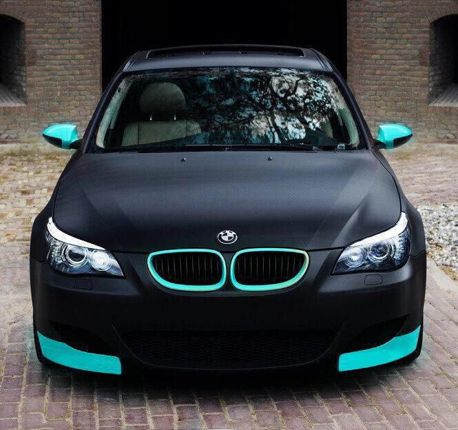 Matte black BMW with blue details