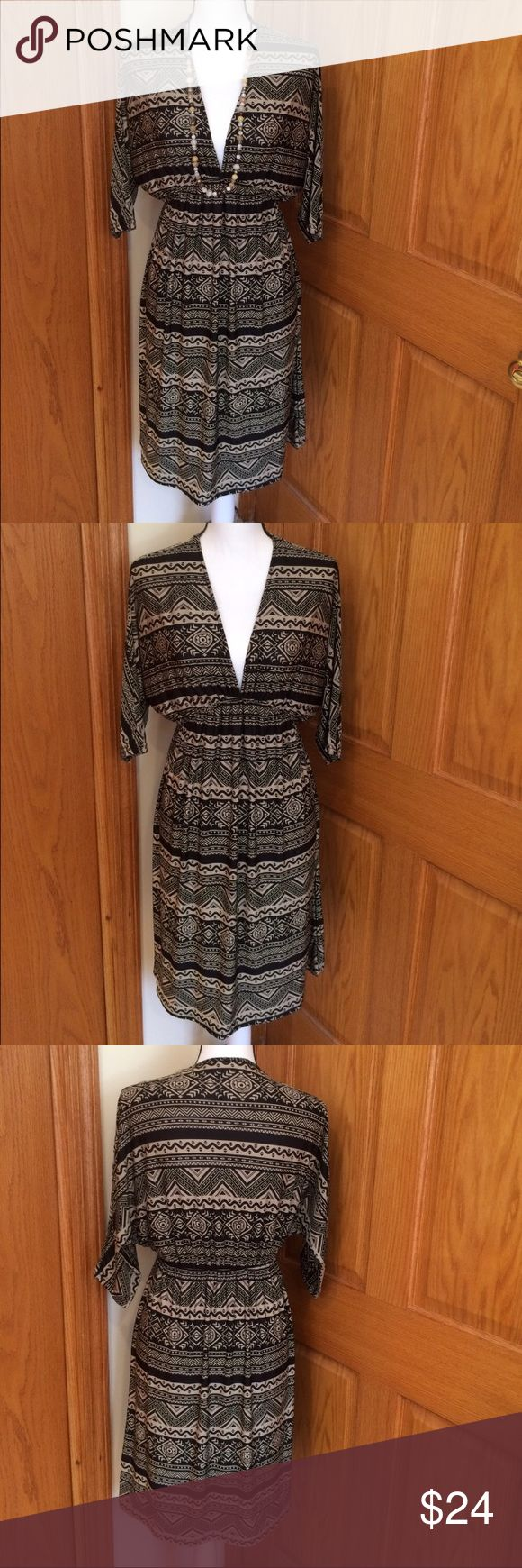 "5th Love Tribal Print Dress Black & Tan tribal print dress with 3/4 sleeves & v - neck. Nice elastic waist. 95% polyester & 5% spandex. Measurements approximately as follows: bust 42"" and length 37.5"". EUC. 5th Love Dresses Midi"