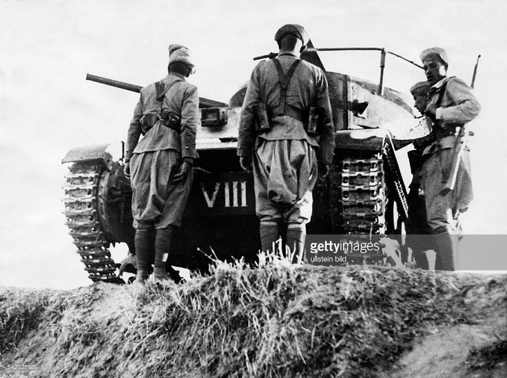 Spain - 1936. - GC - Nationalist troops (Moroccans) east of Madrid near Torrejon (de Ardoz) with a captured Soviet tank (T 26) - late October…