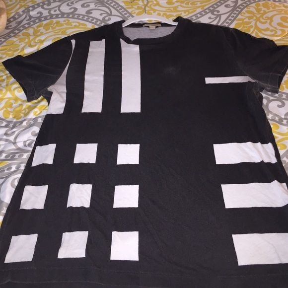 ONE DAY SALEAuthentic Mens Burberry T-Shirt I wore it as an oversized shirt. It is faded, all over and under the arms and a minor stain in the center. But overall its a good shirt. Reasonable offers welcomed Burberry Tops Tees - Short Sleeve