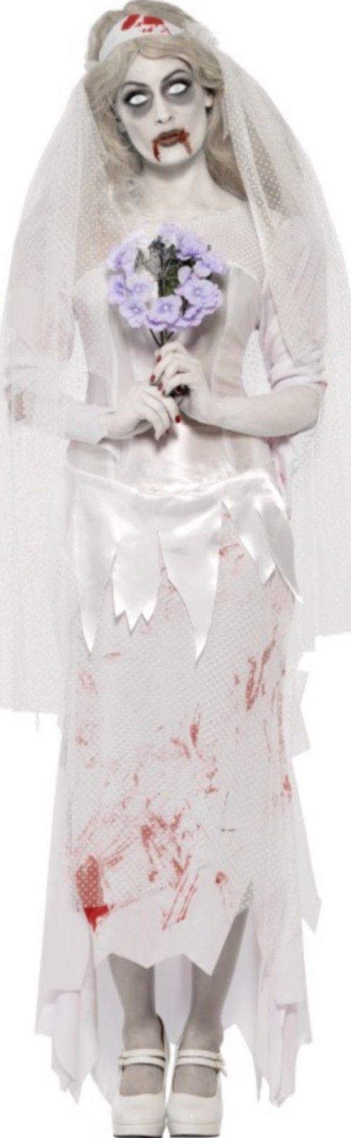 Halloween Zombie-Braut-Kostüm für Damen: Dieses Halloween Zombie-Braut-Kostüm für Damen beinhaltet ein Kleid, einen Schleier und einen Blumenstrauß. (Strumpfhose und Schuhe nicht inbegriffen)Das Kleid ist natürlich...