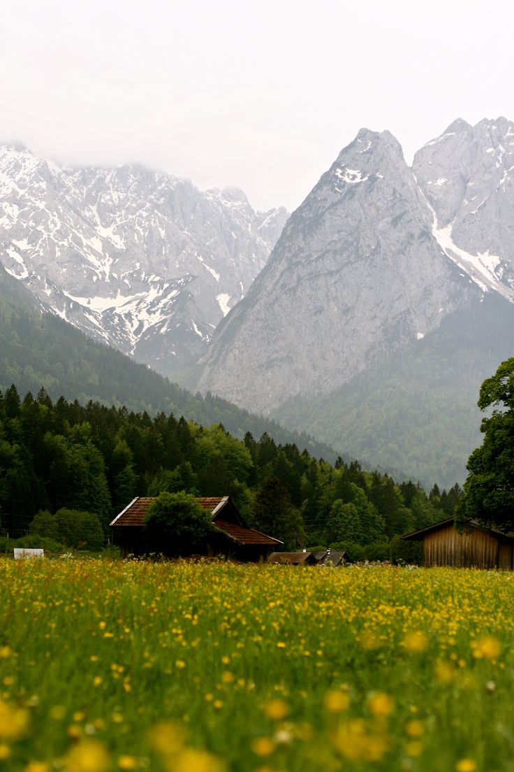 German Alps - Garmisch - Germany Truly my favorite little town in the world. My husband and I extended our stay we loved it so much and cannot wait to go back. This mountain was the view form our guest house balcony. Such a magical place!