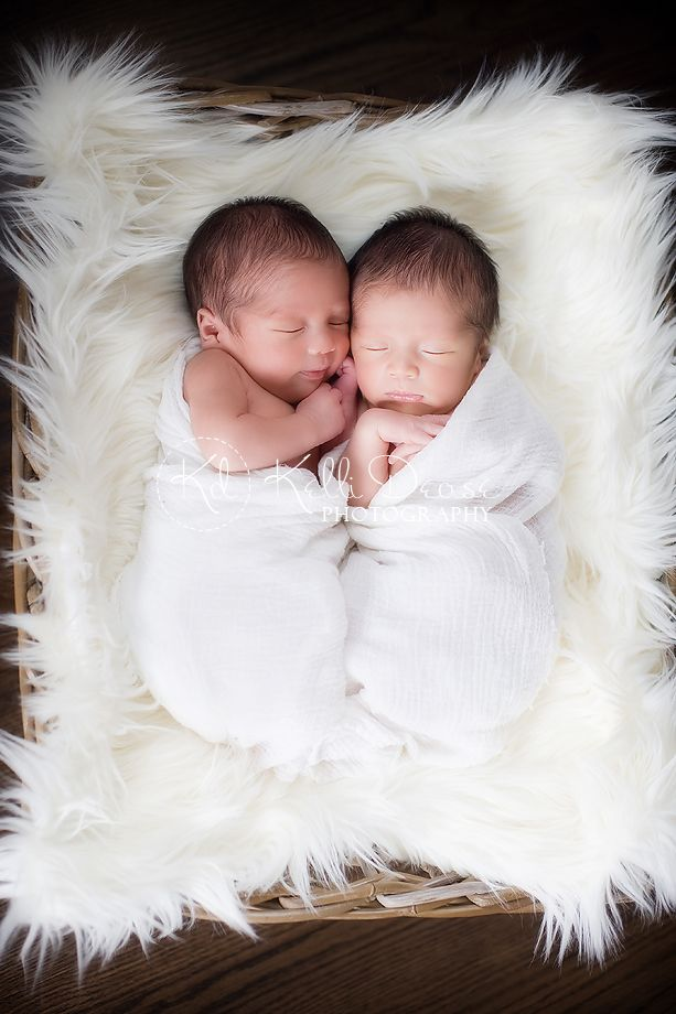 Kelli Dease Photography... Such a beautiful photo of twin baby boys! The white fluffiness makes these two even more snuggly than they already are.  This is almost too cute to handle!