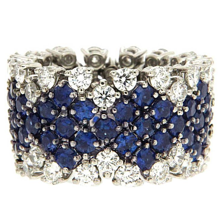 This unique flexible Sapphire and Diamond Band is made with diamonds total weight of around 3.4ct. Blue Sapphires total weight 5.85ct. Finger size 6.5 - 7 Other sizes available upon request.