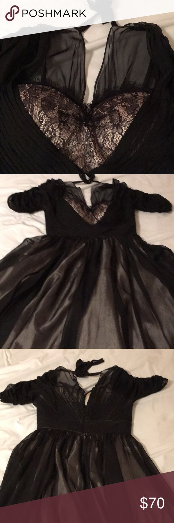 NWT Tempest Storm dress Gorgeous black dress with sheer overlay and sheer short sleeves. Full skirt fully lined. Material under is silky gold. Beautiful. Never worn. Tempest Storm Dresses