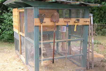 LOOK CLOSE at the TOOLS HANGING on this chicken coop... Good Idea: