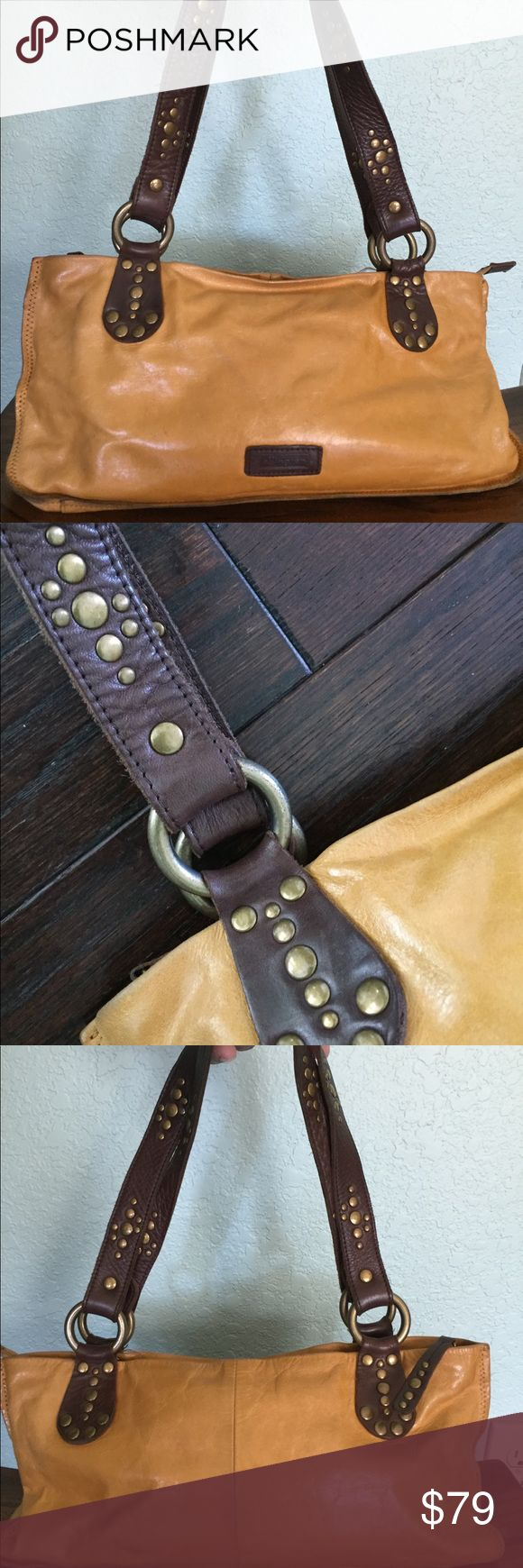 """Ellington soft leather handbag in mustard Soft supple Ellington leather handbag. It has an embellished shoulder/hand strap with three interior pockets and a key fob. In great condition with only minor flaws as shown in pics. Perfect mustard color covers all seasons. Measures 14"""" L x 6.5"""" H Ellington Bags"""