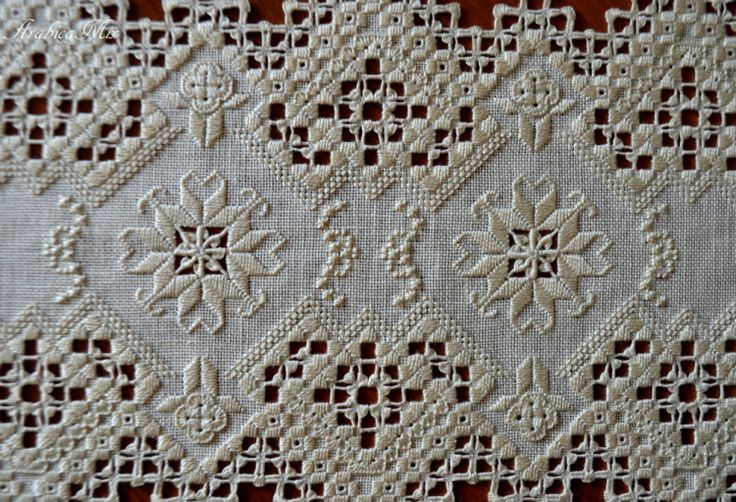 Hardanger - note the tiny little crosses using buttonhole stitch