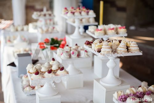 Wedding reception dessert table with delicious decorated white c