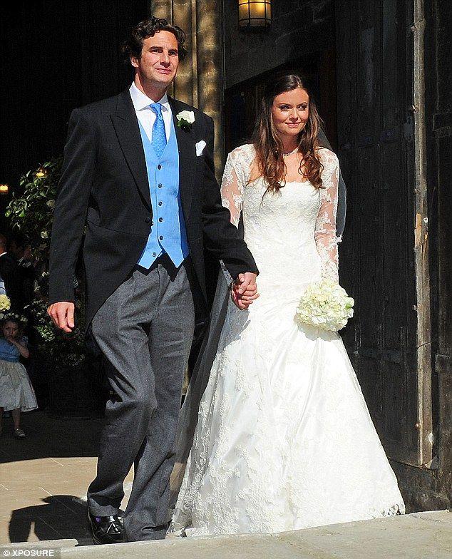 6/8/13.   Picturesque: Natasha Rufus-Isaacs married her lawyer boyfriend Rupert Finch today
