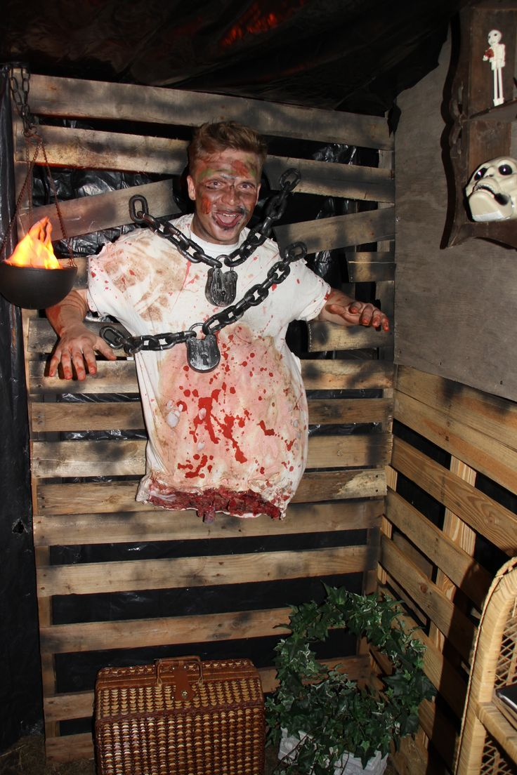 Decor Haunted House Decorations With Someone Whose Body Is Truncated Tied  With Chains On Wooden Wall Ideas For Haunted House Decorations Homemade.