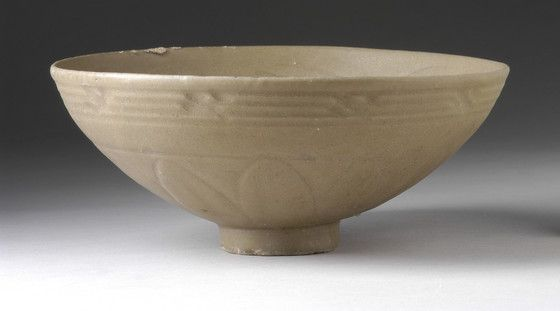 Bowl (Wan) China, late Jin to early Yuan dynasty, 13th-14th century Furnishings; Serviceware Longquan type ware, wheel-thrown stoneware with carved decoration and green glaze Height: 2 3/4 in. (6.99 cm); Diameter: 6 3/8 in. (16.19 cm) Gift of Ambassador and Mrs. Edward E. Masters (M.84.213.369)