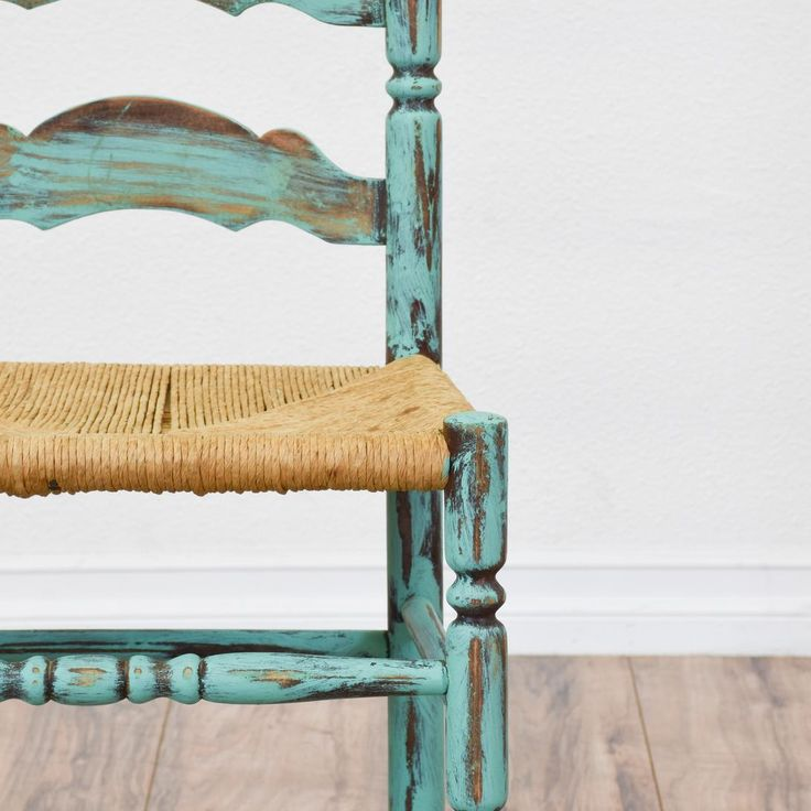 Set of 4 Light Blue Shabby Chic Ladder Back Chairs - This set of 4 shabby chic ladder back chairs are featured in a solid wood with a distressed light blue chalk paint finish. These dining chairs are in great condition with tall ladder backs, carved spindle legs and woven wicker seats. Eclectic chairs perfect for casual dining in a breakfast nook! Loveseat is the best way to buy vintage home furniture in San Diego & Los Angeles. Shabby Chic, Vintage, Mid Century Modern and much more.