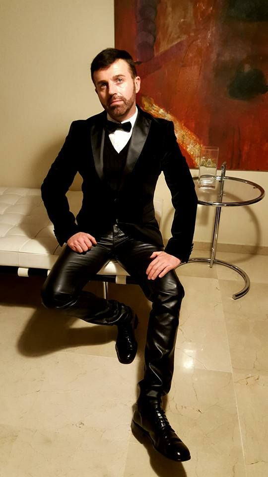 matthew white in a tight leather suit