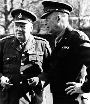 General Eisenhower talking with British Prime Minister Winston Churchill in military uniform - date and location unknown.  Two big reasons we won!!