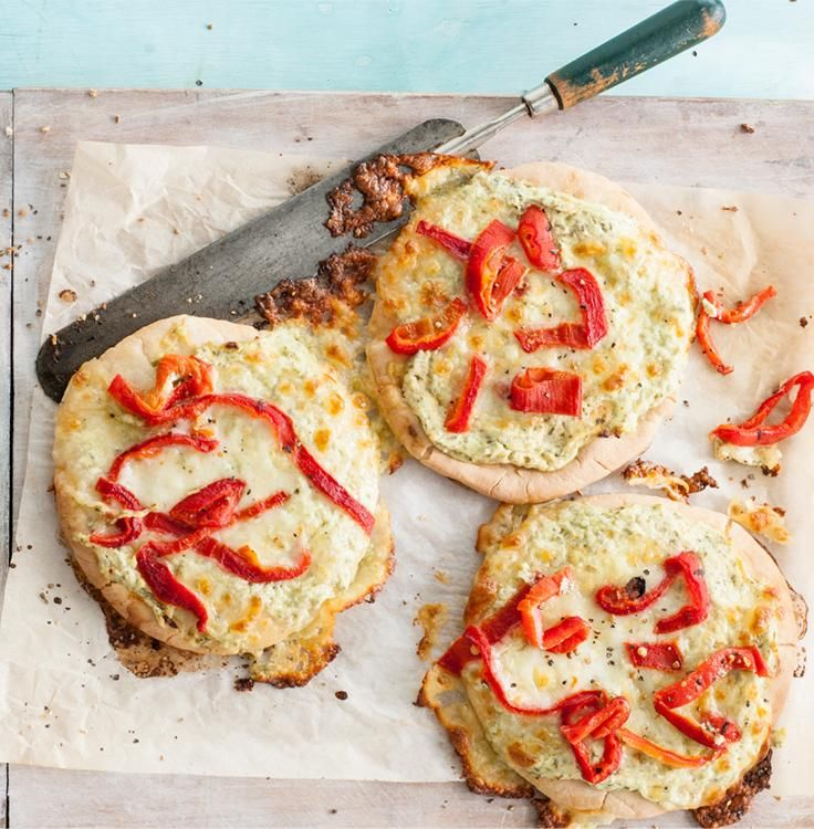 These pita pizzas are a satisfying blend of savory pesto and sweet peppers. A duo of creamy cheeses brings everything together.
