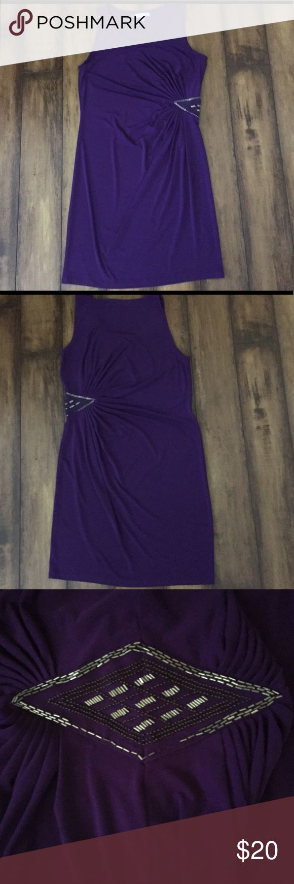 JENNIFER LOPEZ CLINGY DRESS WITH SEQUINS Pretty purple colored sleeveless clingy dress with a beautiful sequin father at waist. Some of the sequins are missing as shown in pictures, price reflects thus flaw. Jennifer Lopez Dresses Mini