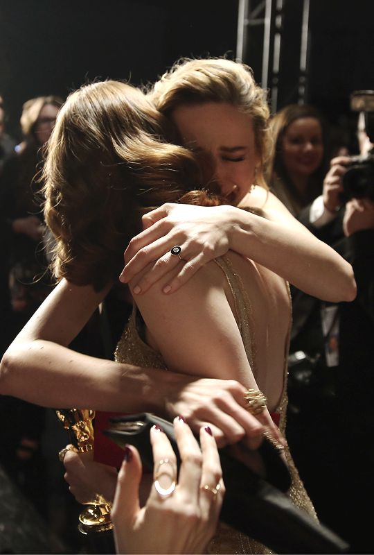 Brie Larson embraces Emma Stone, winner of Best Actress for 'La La Land,' backstage at the 89th Annual Academy Awards at Hollywood & Highland Center on February 26, 2017 in Hollywood, California.