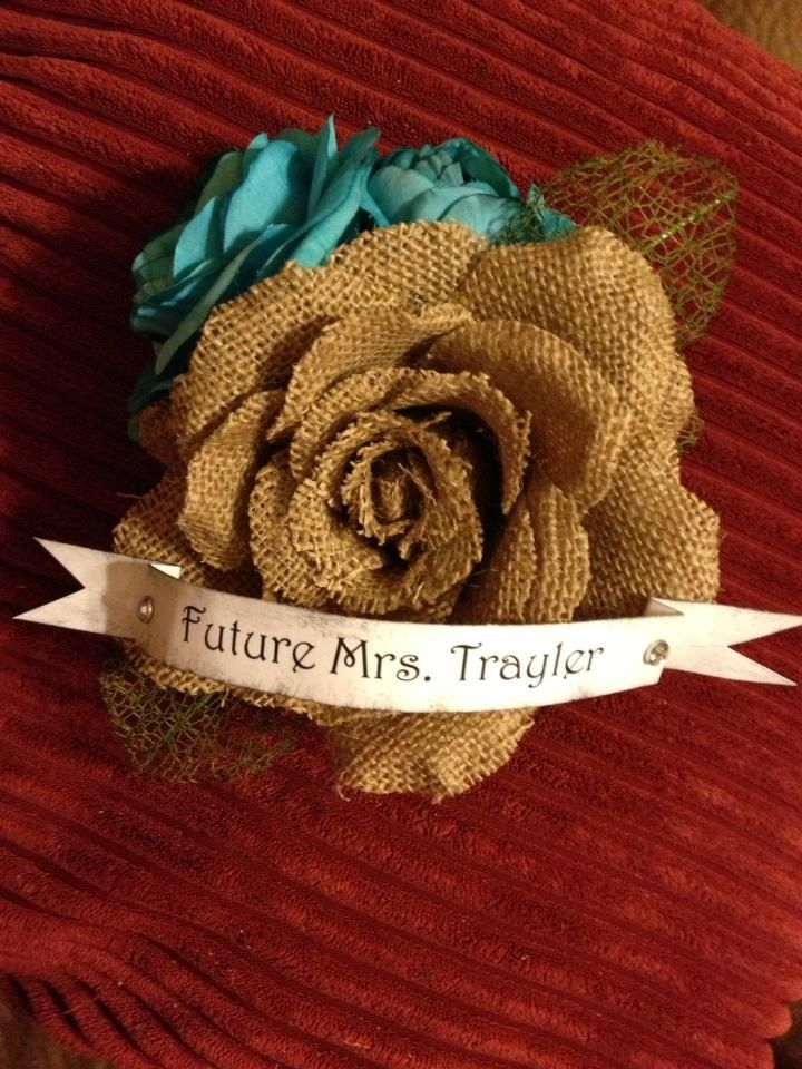 Bridal shower corsage...and only cost $5 to make! flowers from hobby lobby (used coupon) including the burlap one, used green floral tape and hot glue to keep them together. printed out banner and distressed with distressed ink. Super easy!