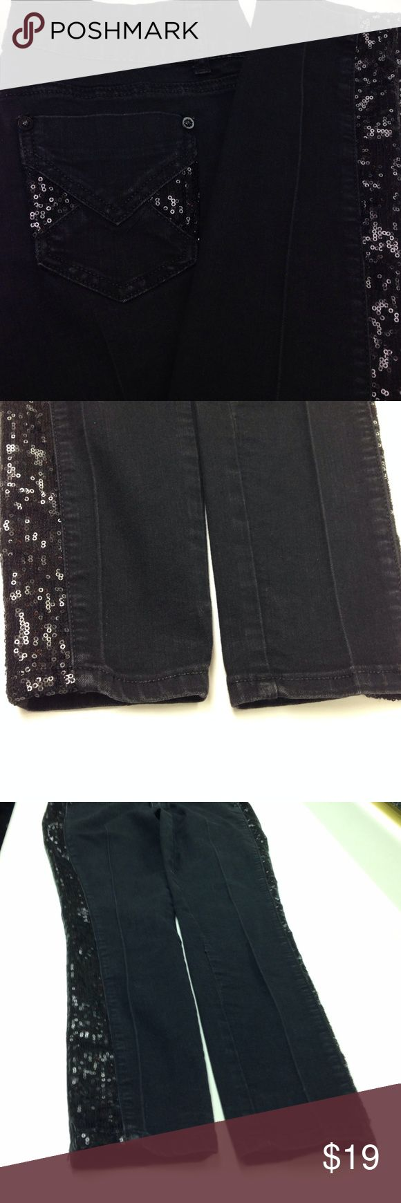 2b bebe Black Sequin Jeans 2b bebe black jeans with black sequins on back pockets and down length of sides of each pant leg. There is a PRESSED SEAM down length of front and back of pant legs. The seam is off center on right leg. Jeans have some faded spots but are in good condition. Price is reflective of jean flaws. Skinny jeans/jean legging type bebe Jeans Skinny