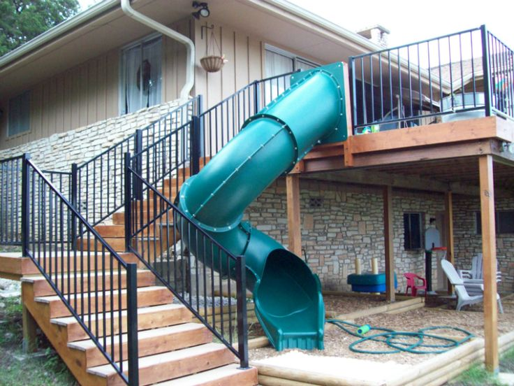 A slide is a great way to add fun and uniqueness to your two story deck.  Plus the kids will love it!