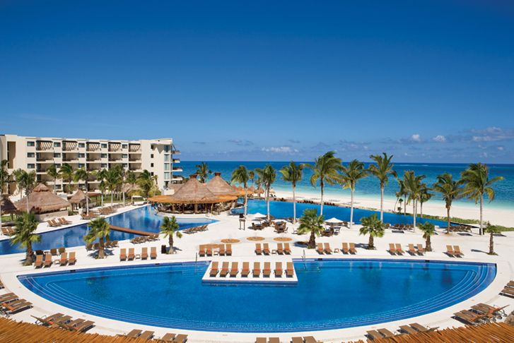 Dreams Riviera Cancun Resort & Spa on  the white sand beaches of the Riviera Maya!  Nine restaurants, 6 bars, big screen movies on the beach, 2 large pools, 2 oversized kids pools,
