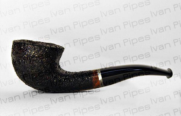 Curve rusticated briar pipe