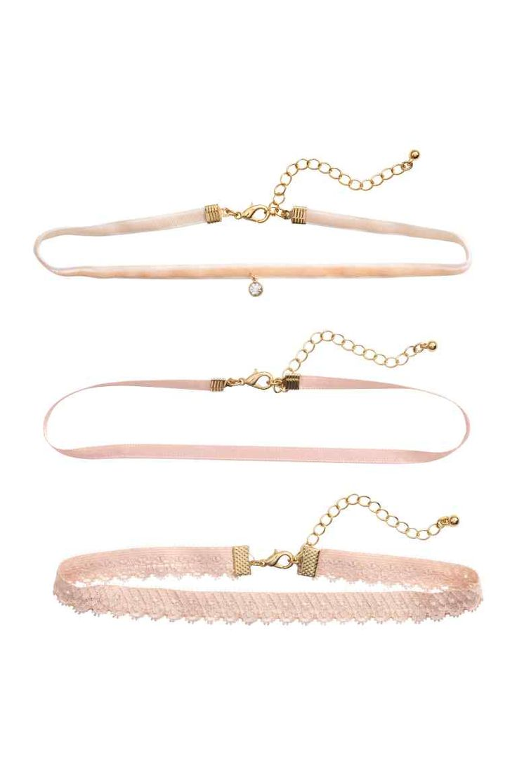 3-pack chokers: Short, narrow fabric chokers in different styles. One in velvet…