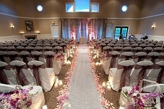 I really love this look of the flower petals beside the aisle runner. Of course, you can use fake petals to save money! :)