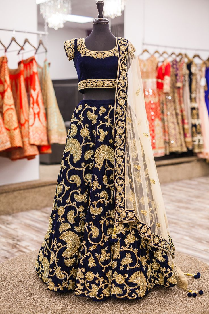 Here's a look at this breathtaking blue micro velvet lengha! It has asymmetrical jaal embroidery using dori and metal sequins! The asymmetrical embroidery gives this piece a very unique and versatile look and the definitely adds that royal touch! #lehenga #bridal #wellgroomed #punjabi #indian #bespoke