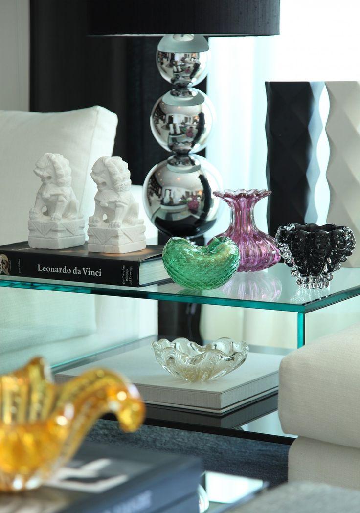 Murano glass, check.  Foo Dogs, check.  Art Books, check.  Glass table and chrome lamp, check.