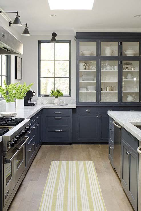 Gray shaker cabinets with the marble countertops is gorgeous.  The glass and shelves look perfect with the windows.