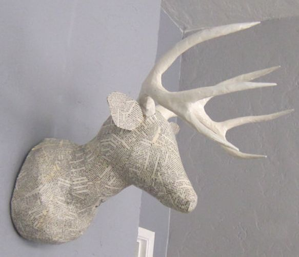 Deer head made from pages of the dictionary