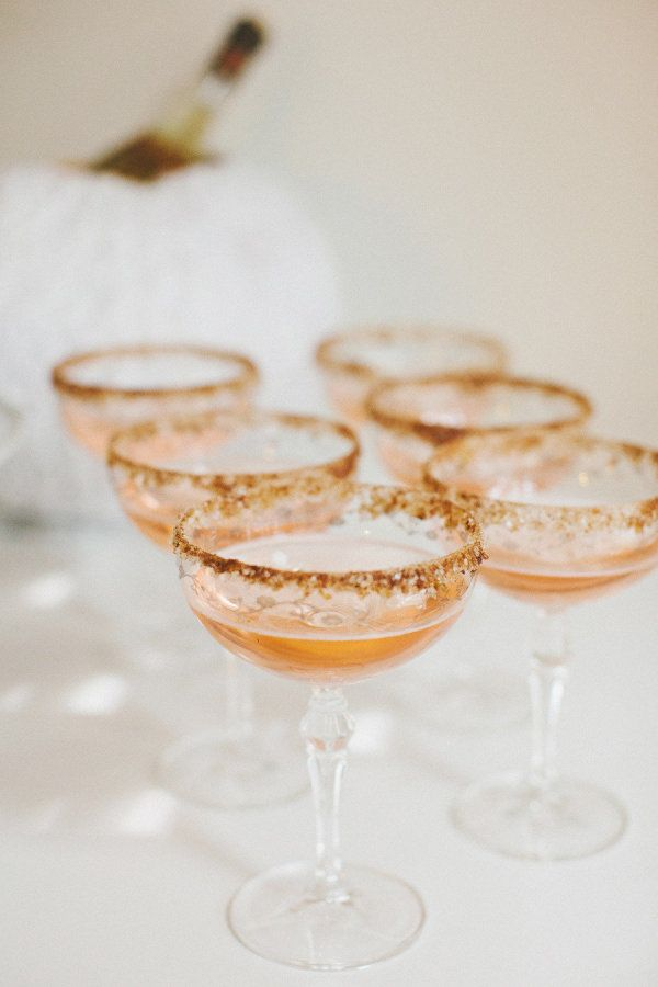 Apple Cider + Champagne cocktails with a pumpkin pie spiced rim!