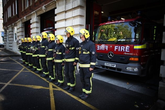 Members of Clerkenwell Fire Station's Green Watch observe a minutes silence for their fellow fire-fighters who lost their lives in the 9/11 terrorist attacks in New York, September 11, 2011 in London, England. Ceremonies held around the world have joined Washington and New York as they commemorate the tenth anniversary of the 9/11 terrorist attacks where nearly 3000 people died when four hijacked airliners were used in coordinated attacks against the United States. (Photo by Peter…