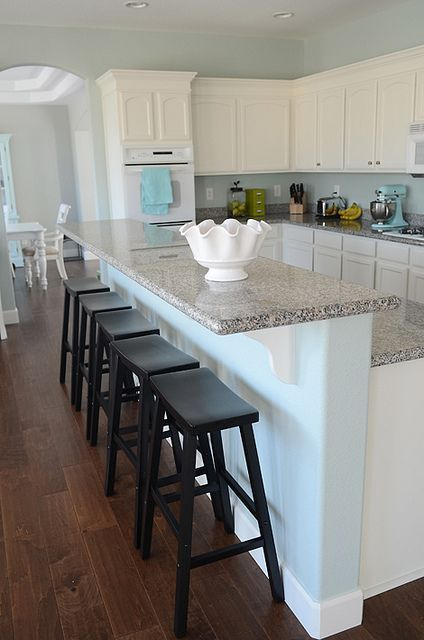What I don't like for the space: different height bar counter White Kitchen With Dark Wood Floor Designs from @hgsphere