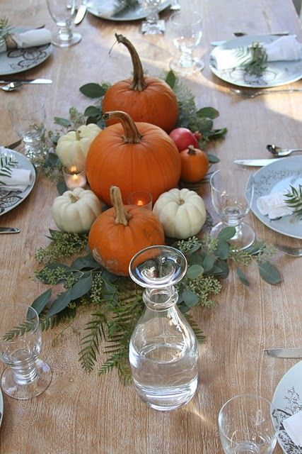 Fall centerpiece.  So simple and so beautiful. Maybe too expensive with that many pumpkins per table? I don't know. Certainly less work than doing arrangements in 40 some pumpkins per table.