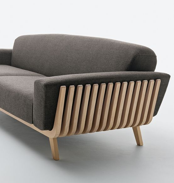 Hamper Sofa is a minimalist sofa designed by Arturo Montanelli and Ezio Riva. Solid wood takes centre stage in this product, inspired by northern European style. The visible frame consists of fourteen solid wood slats in a parallel formation, resembling the shape of a hamper. This structure holds the upholstered seat, back and arms. The nature of the wood therefore goes hand in hand with comfort, in a design solution with a strong visual impact. (1)