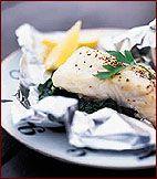 Foil-Baked Sea Bass with Spinach Recipe on Food & Wine | I would use a little less butter to make it lighter